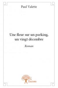 Une fleur sur un parking, un vingt décembre